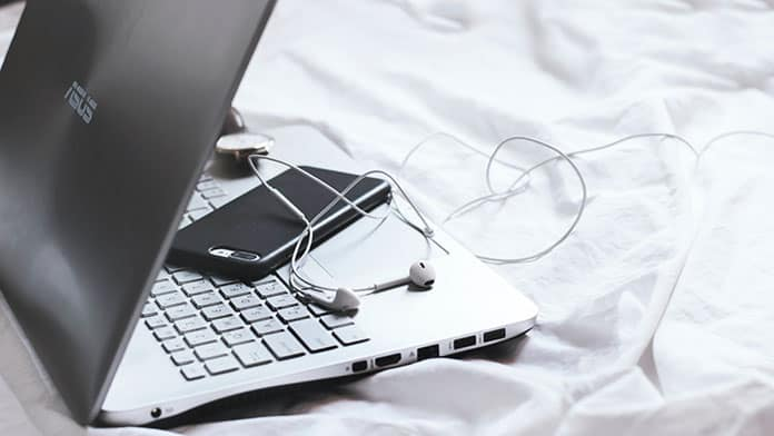 using laptop on bed makes fans loud